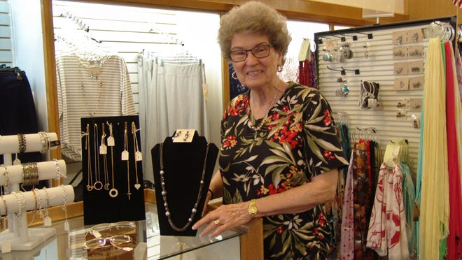 Lynn Weaver stands by the jewelry counter at Carton's Shoes and Ladies Apparel. Weaver said while Coshocton has had some rough times, promoting local businesses is part of the key to success as a community.