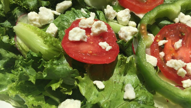 Crumbled blue cheese gives some kick a leafy green salad