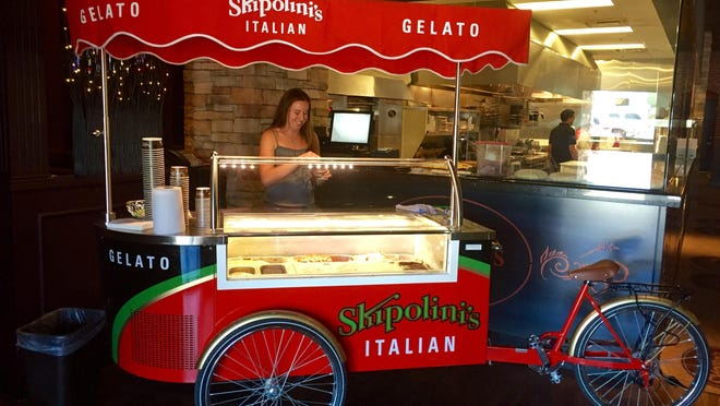A gelato bike greets folks at the entrance to the new Skipolini's Italian in the Summit.