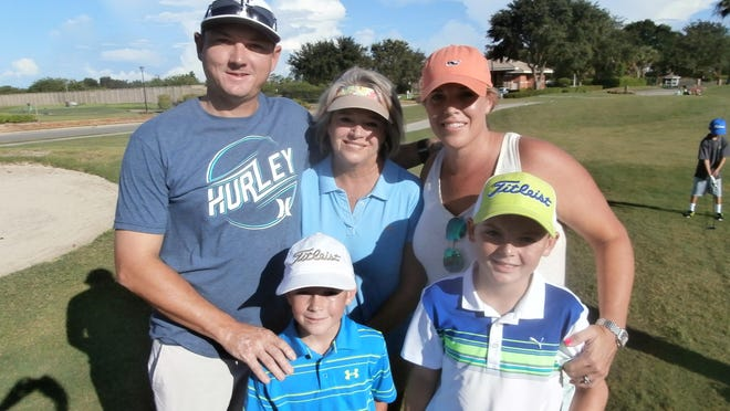 Jack and Griffin Henry, from left to right, are cheered on by Kevin Henry, their grandmother Lori Taylor, and Megan Henry at the Drive, Chip & Putt Championships regional qualifying at Stoneybrook Golf Club.