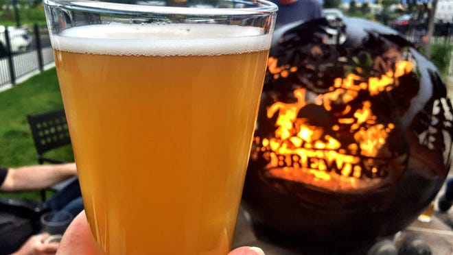 Cheers to a warm fire taking the chill off the patio at Canyon Creek Brewing on the west end of Billings.