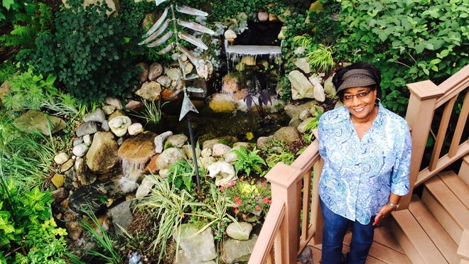 Donna Comer's garden, featuring a waterful, koi pond and lots more, is one of several stops on the Aug. 6 garden walk in Farmington and Farmington Hills.