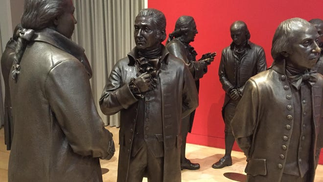 Associated Press PhotosLife-size bronze sculptures of the signers of the U.S. Constitution are shown in the Signers' Hall at the National Constitution Center. The room is designed to give visitors a sense of what it was like for the Founding Fathers to huddle in a room debating and writing the famous document. This July 7, 2016 photo shows life-size bronze sculptures of the signers of the U.S. Constitution in the Signers' Hall at the National Constitution Center. The room is designed to give visitors a sense of what it was like for the Founding Fathers to huddle in a room debating and writing the famous document. (AP Photo/Beth J. Harpaz)