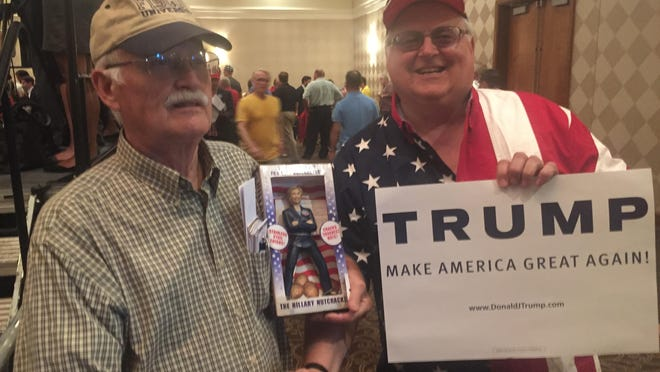 """From left, Glenn Fiscus of Charlotte, N.C. with his Hillary Clinton """"nutcracker"""" and Tom Llewellyn of Milford Township at the Trump/Pence rally at Suburban Collection Showplace Thursday in Novi."""