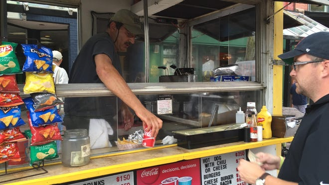 David Stoll, owner of Boo-kie's food cart on Church Street, is selling his business for $25,000.
