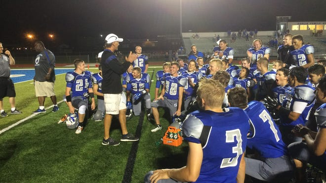 Green Bay Southwest co-head coach Tim Birr celebrates with his team after a 17-6 victory over Pulaski on Friday at Dahlin Family Stadium in Green Bay.