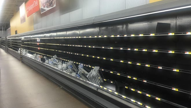 A line of empty shelves Saturday night at the Walmart Supercenter on Lagniappe Way.