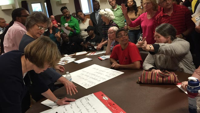Participants share ideas at a Rochester-Monroe Anti-Poverty Initiative forum in July 2015. The need for adult mentoring, which will be implemented this fall in three northeast neighborhoods, came from events such as this.