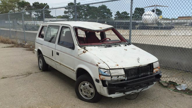 This Aug. 18, 2016 photo provided by the Port Authority shows a van damaged in the Sept. 11, 2001 terrorist attacks on the World Trade Center, outside Hangar 17 at the JFK airport in New York. When the Port Authority shuttered the artifact program in August, officials moved the only remaining artifact to the tarmac. (Amy Passiak/Port Authority of New York and New Jersey via AP)