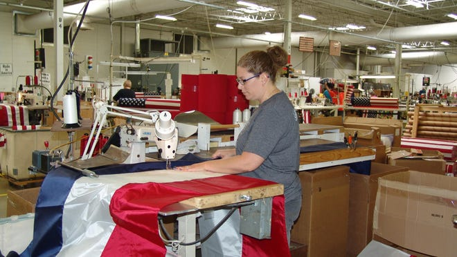 Melissa Rhodes works on a flag at Annin Flagmakers in Coshocton.