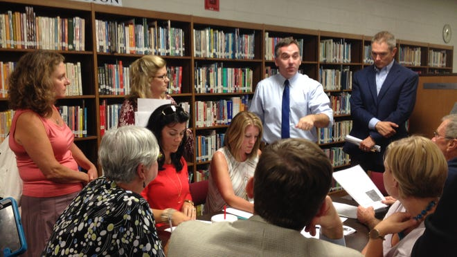 (Sept. 28, 2016) Germantown Schools Superintendent Jason Manuel (standing, second from right) talks with participants during a public discussion at Houston High's library on the proposed site of a new school. (Photo by Daniel Connolly)