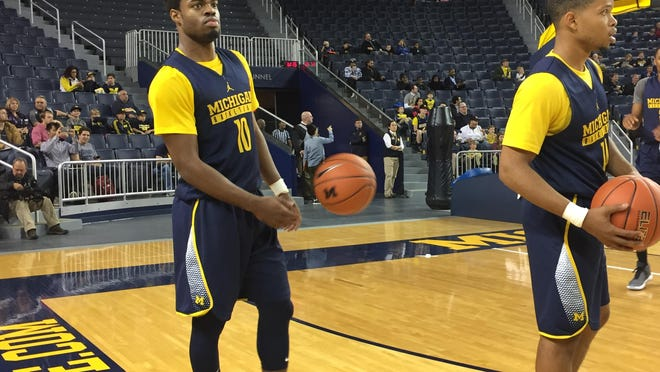 U-M's Derrick Walton Jr. waits for instructions at Tuesday's practice at the Crisler Center. Fans attended the open practice and selfie night.