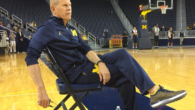 Coach John Beilein watches the practice Tuesday at Crisler Center in Ann Arbor. Beilein was miked so the fans could hear some of the things he said to the players.