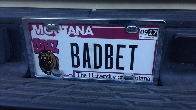 """Brian Oswood of Great Falls said it's """"not comfortable"""" to be a Bobcat fan with Griz plates, especially when he has to work in Bozeman. But, he honors his standing bet with his stepdaughter, a Griz fan who has to get Bobcat plates when the Griz lose the Cat-Griz game."""