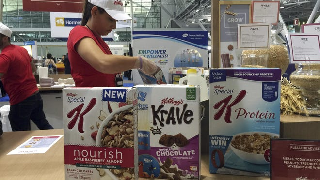 "FILE - This Oct. 16, 2016, file photo shows the Kellogg booth at an annual dietitians' conference, where company representatives explained the health benefits of their products, in Boston. On its website, amid news of Pop-Tarts and Frosted Flakes, Kellogg touted a distinguished-sounding ""breakfast council"" of ""independent experts"" dedicated to guiding its nutritional efforts. Nowhere did it say that Kellogg paid the council members and spoon-fed them talking points about the benefits of cereal and breakfast, according to a copy of a contract and email exchanges obtained by The Associated Press. (AP Photo/Candice Choi, File)"
