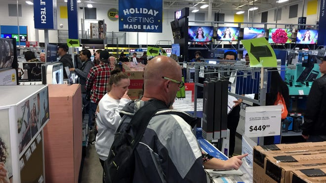 People gathered and lines grew for Black Friday deals, Thursday night at Best Buy in Visalia.