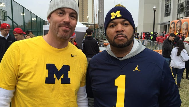 "Michigan fans Jed Hoefer, left, and Eugene Douglas hang out near the ESPN ""College Gameday"" show on Saturday in Columbus, Ohio."