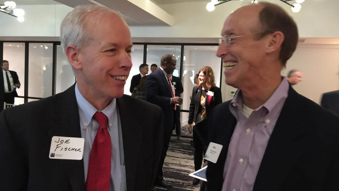 """Rep. Joseph Fischer, left, R-Fort Thomas, speaks with Mike Hammons, director of advocacy for Children Inc., during the Northern Kentucky Chamber's """"Where We Stand"""" reception at Hotel Covington. The second day of the legislative session saw a House committee pass two bills recommended by the NKY Chamber."""