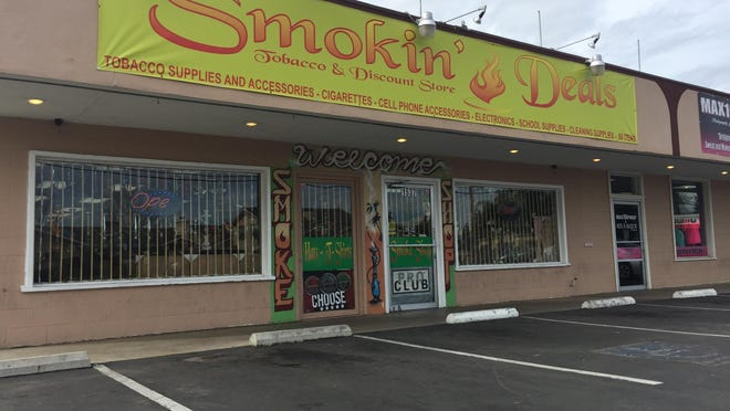 "Police said Mr. Kush Smoke Shop, Stuffed Pipe Smoke Shop and Smokin Deals Smoke Shop were found in violation and issued ""cease and desist orders."""