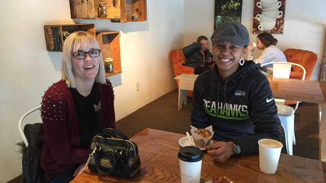Melanie Hauer, left, and Tiffany Waldren enjoy coffee and food at Crooked Tree in Great Falls. Both ladies say that although it can be tough, ditching the meat doesn't mean they can't enjoy eating out.