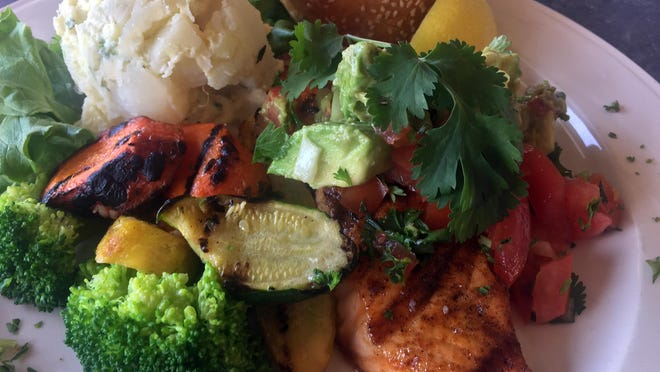 Grilled salmon with avocado and tomato salsa, grilled vegetables, steamed broccoli, and homemade potato salad