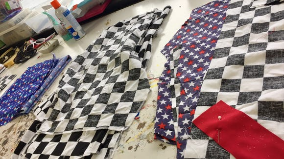 Meet the genius costume designer behind the patriotic, Indy 500-themed male rompers
