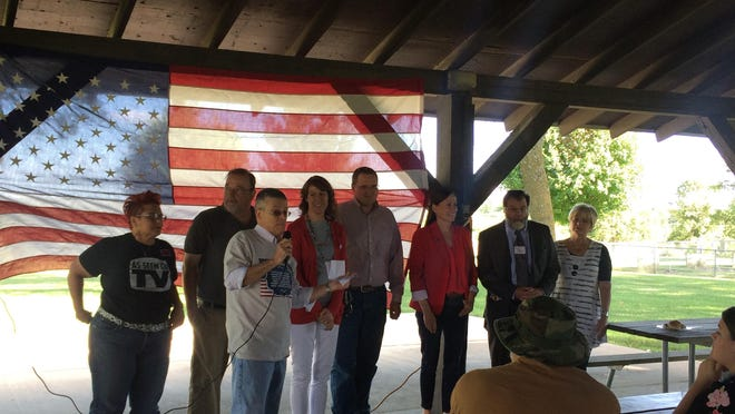 Warren County Democrats Chairman David Betsworth introduces possible 2018 candidates during a picnic on June 25. Candidates from left to right are: Heather Ryan, Pete D'Alessandro, Cynthia Axne, Ryan Marquardt, Theresa Greenfield, Paul Knupp and Vicky Brenner. Marquardt and Brenner are after state Rep. Stan Gustafson's seat, while the rest are hoping to run for Iowa's 3rd Congressional District.
