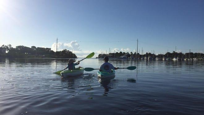 Dan Lindemann and his grandson Cooper Lindemann take a morning kayak cruise on Bayou Chico.
