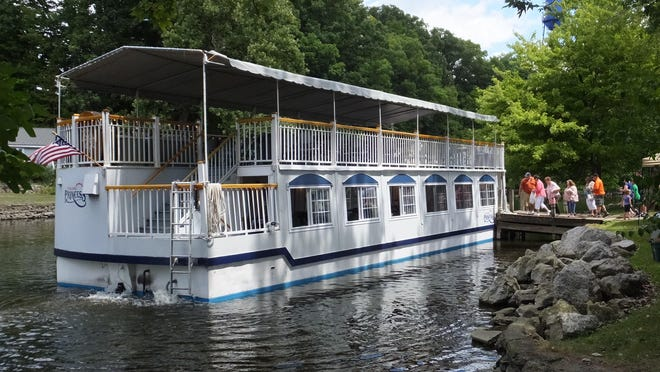 A blissful ride on the Grand River aboard the iconic River Queen is popular among Island Art Fair visitors every year.