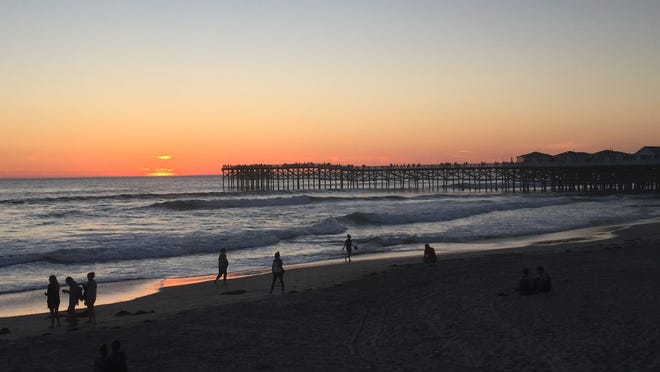 Sunset on Pacific Beach in San Diego, with Crystal Pier as a backdrop.