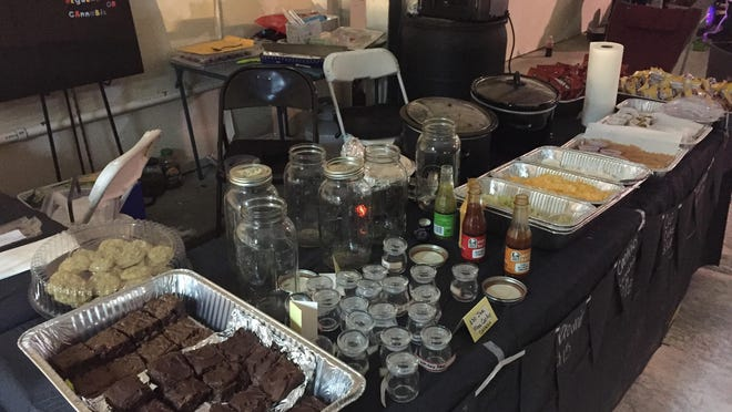 "Several people were arrested Friday night after police raided an east-side licensed medical marijuana dispensary that was hosting what authorities described as a ""flea market"" selling a variety of cannabis-laced foods."
