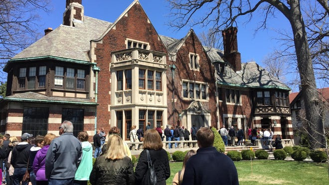 By noon Sunday, hundreds were in line to tour the Charles T. Fisher mansion, which is now owned by actor Hill Harper.
