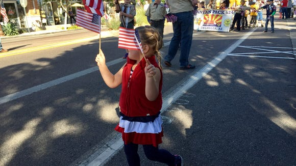 We taught her to love a parade. (Photo: Karina Bland)