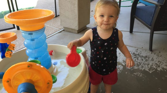 The Little Tikes Spiralin' Seas Waterpark Play Table keeps babies soaked and happy. Keep it on a shaded patio or under an umbrella. Credit: Jennifer McClellan