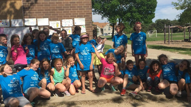 Wallace Elementary's Girls on the Run club organized a lemonade fundraiser and run for Kyla Tome, center wearing a hat, who is fighting cancer, on May 17, 2018.