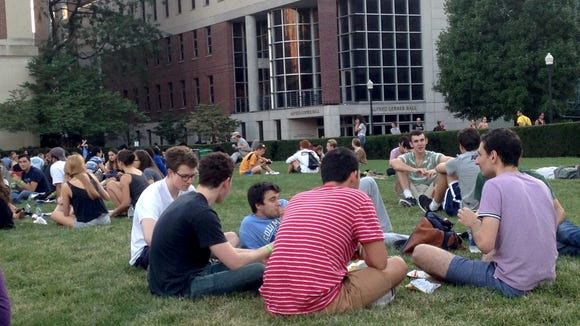 Students eat dinner outside at Columbia University's first annual Lawn Party. The price of admission was one meal swipe, or $20—a hefty amount for some students who may be balancing expenses like tuition, rent, or sending money home to their families.