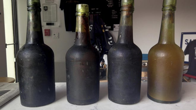 In this July 17, 2017, photo provided by Jamie Adams, four bottles recovered from the SS Oregon, a 133-year-old shipwreck, are shown at the Saint James Brewery in Holbrook, N.Y. Bill Felter of Serious Brewing in Howes Cave, N.Y., hoped to develop a new brew from ale salvaged from the SS Oregon. But the scuba-diving Long Island brewer, Adams, has scuttled those plans, saying he owns the shipwreck yeast and has used it to produce ale he's releasing in March 2019.