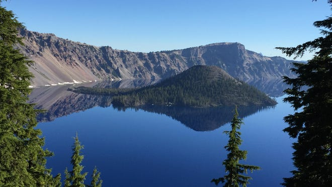 Wizard Island juts above the azure waters of Crater Lake National Park.