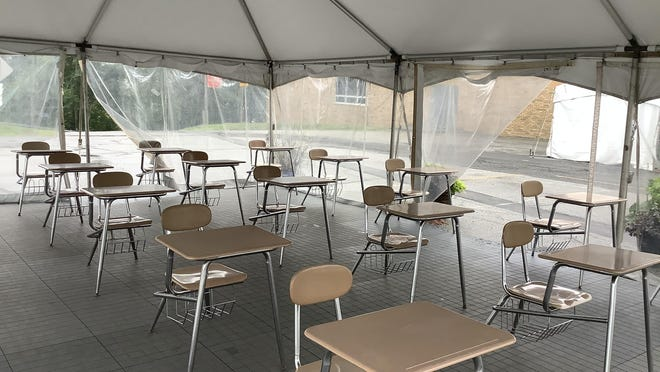 Sussex County Community College officials have set up two outdoor tented areas as temporary classrooms to keep students socially distanced as part of the college's plan to reopen for the fall semester.