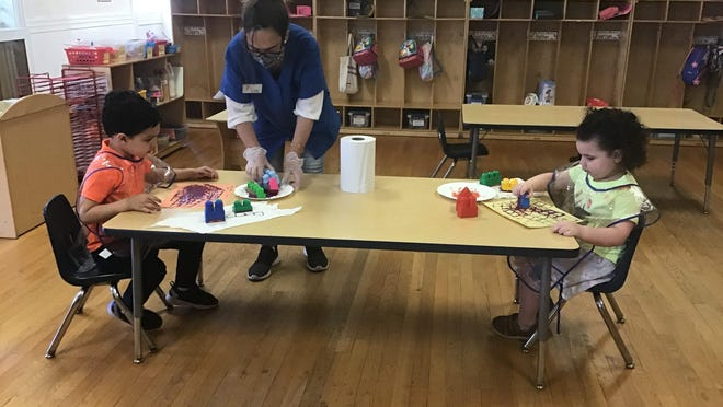 Children return to child care at Greater Bergen County YMCA with appropriate social distancing measures in place.