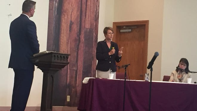 Ohio Supreme Court Justice Sharon L. Kennedy (center) makes a point during a Supreme Court Educational Forum Sunday at the Chili Crossroads Bible Church near Fresno in Coshocton County. She was joined by Ohio Supreme Court Justice Judi French (right). The church's pastor, Neal Dearyan (left) served as moderator.
