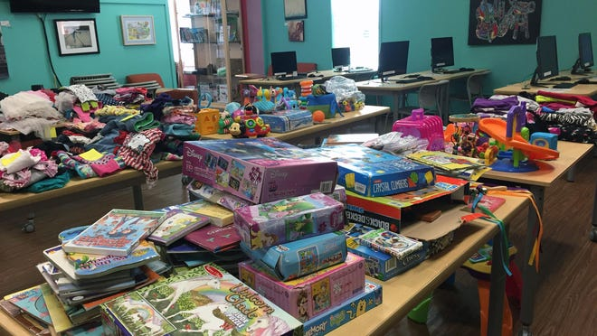 Pottsboro's library continually steps forward to help its community share the good things in life whether it be internet access or the piles of toys and clothes shown in this 2018 file photo from a clothes and toy swap sponsored at the library. [Jerrie Whiteley / Herald Democrat].