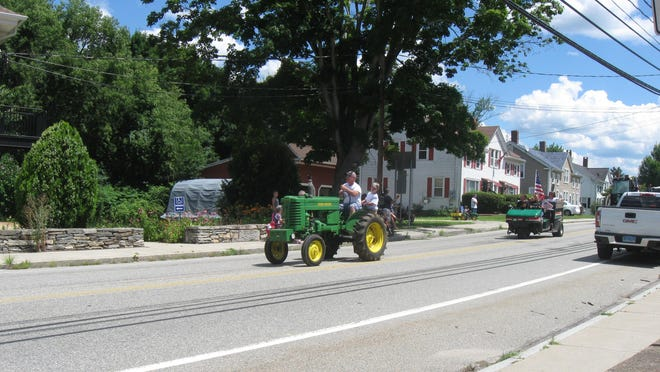Farm vehicles parade through Sprague on Saturday in a tribute to local farmer Art Spielman Jr., who died last month.