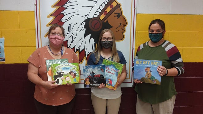 "The JoDaviess County Farm Bureau offered a ""Bushel of Books"" grant to school districts within the county with the goal of providing accurate agriculture books for elementary students. Pictured, from left: Jeni Pearce, Hannah Brudi and Angela Kurth."