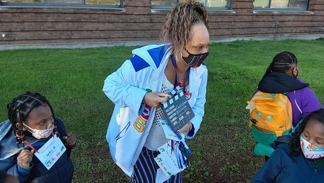 Roosevelt Magnet School teacher Deanne White welcomed her first graders to the first day of in-school learning in PPS with a miniature director's clapboard to contribute to the Hollywood VIP theme of the morning.