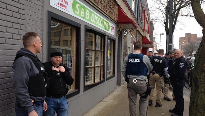Federal police, assisted by local officers, conducted a raid at S & B Discount, 1207 Broadway, Rockford, on Wednesday, Jan. 18, 2017. S&B was one of several businesses investigated as part of an alleged food stamp fraud scheme.