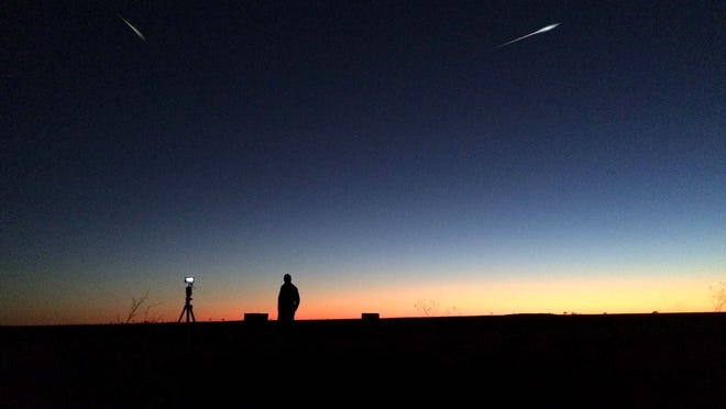 "Bright objects zip through the darkening heavens in ""Fireball."""