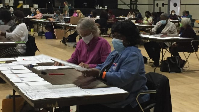 Poll workers at the Bell Auditorium recount votes for Richmond County on November 14, 2020.