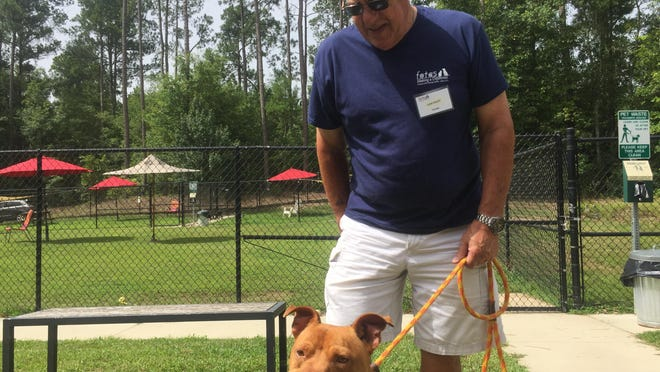 John Sauer from Friends of the Animal Shelter walks Scrappy during an adoption event for first responders at the Aiken County Animal Shelter on Saturday, June 27, 2020.