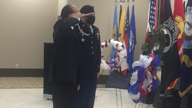 William Kingsberry (left), former POW advocate and representative for the Charlie Norwood VA Medical Center, and a soldier salute a wreath placed in honor of Prisoners of War and those missing in action at the Fort Gordon Conference and Catering Center Friday, September 18, 2020.